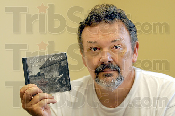 BLEVE:Mickey Milam holds his Randy Owen release that will be sold to benefit fallen Terre Haute police officer Brent Long. The proceeds with go to the Long family.