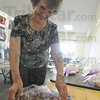 Tribune-Star/Rachel Keyes<br /> Best of bakers: Grand Champion Barbara Mericle unwraps her prize winning cookie at the Baker's Auction.