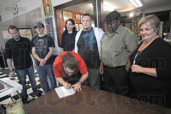"Tribune-Star/Rachel Keyes<br /> John Hanncock: The Band ""From the Ruins"" Rusty Sparks, Chad Anderson, Tim Hartman, Robert Myers, Jeff Garloch sign a five year deal with Seki Records and owners Art Obaseki and Linda Obaseki."