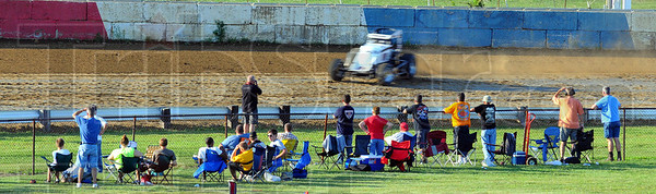 Tribune-Star/Jim Avelis<br /> Crowd pleaser: Dave Darland speeds past spectators while qualifying for the Sprint Week race Wednesday evening.