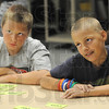 Learning: Deming Elementary School students Trent Shook and Alex Moody listen to teacher Donna Tidd during Wednesday's summer school session.