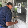 Code enforcement: Vigo County Code Enforcement officer Dale Sowards inspects an abandoned house in Prairieton Wednesday afternoon.