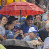 Tribune-Star/Rachel Keyes<br /> Staying dry: Terre Haute Rex's fans try and stay dry during the rain delay early in Saturday's game.