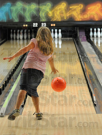 Bowling: Eight-year-old Mayrose Leggett bowls a frame at the Terre Haute Bowling Center Tuesday afternoon. The business is giving two free games per day to children.