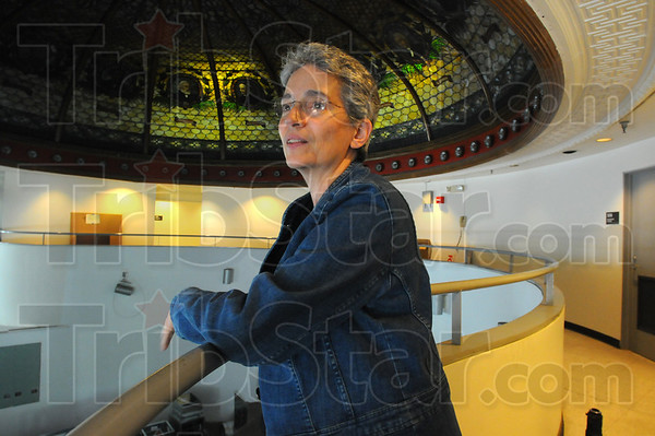 Tribune-Star/Jim Avelis<br /> Watching: Indiana State University art professor Fran Lattanzio looks out over the gallery area of the Fairbanks Hall first floor. The building is undergoing  renovations this summer.