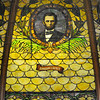 Tribune-Star/Jim Avelis<br /> Backlit: With the renovation work being done on the old Emiline Fairbanks Library, the stained glass windows are partially covered from the top. The panes of Lincoln and a few others are backlit, allowing the rich colors to be seen.