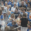 Tribune-Star/Rachel Keyes<br /> Toss it to me: Fans try and catch bags of tee shirts at the last Rex's home game of the regular season.
