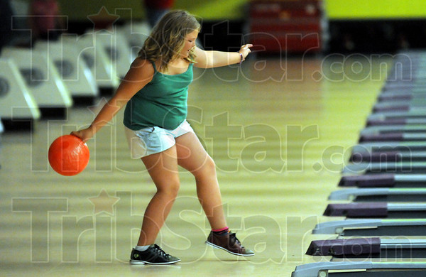 Freebee bowling: Nine-year-old Gracey Rollins tries her luck at bowling at the Terre Haute Bowling Center Wednesday afternoon.