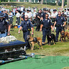 Tribune-Star/Jim Avelis<br /> Honoring: K-9 officers file past Brent Long's casket to pay their final respects to a fellow officer.
