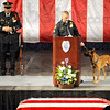 invocation: Sgt. Todd Haller and his K-9 partner give the invocation at the start of officer Brent Long's funeral Monday morning.