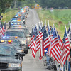 Tribune-Star/Jim Avelis<br /> Honored: The line of several hundred law enforcement vehicles heads west on Davis Avenue to Mt. Pleasant Cemetery.
