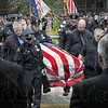 Pallbearers: The casket of officer Brent Long is carried to the waiting hearse after Monday's funeral at Hulman Center.