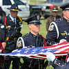 Tribune-Star/Jim Avelis<br /> Ceremony: The Honor Guard of the Terre Haute police force folds the flag that covered Brent Long's casket.