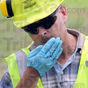 Tribune-Star/Jim Avelis<br /> Sniff test: Steven Stanford, Senior Project Manager for Wagner Boos Consultants, sniffs the moisture pulled from the soils fo the old Terre Haute Coke and Carbon plant. His first impression was of coal chemical odors.