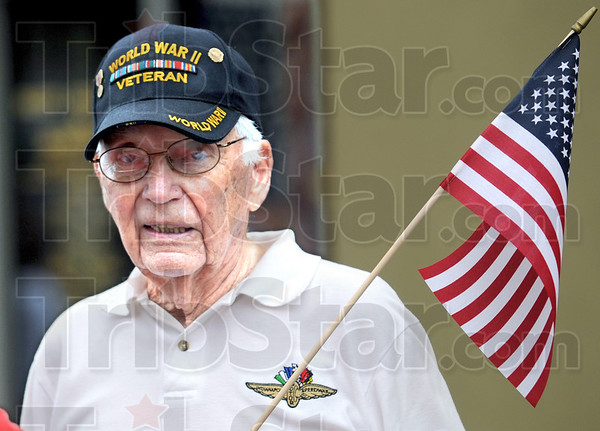 Veteran: World War II veteran, Max Fulmer of Terre Haute  watches the parade down Wabash Avenue Monday morning. Fulmer is 92 years old.