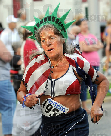 Patriotic: A runner in the women's Mayor's Cup race shows her patriotic spirit.