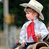 Cowgirl:  Three-year-old Laney Query rides her horse during the parade down Wabash Avenue Monday morning.