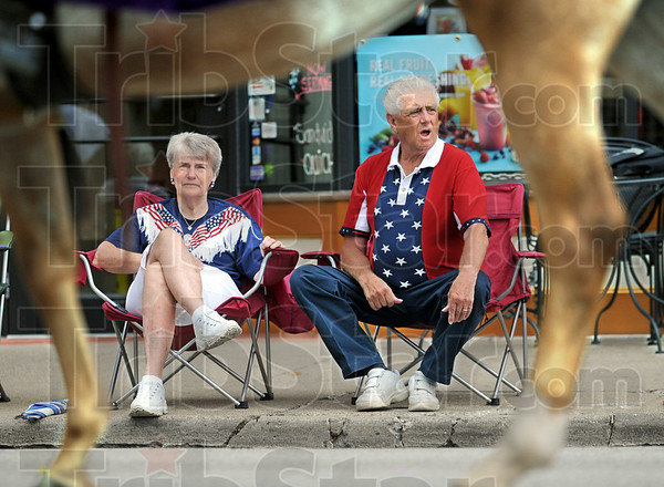 Parade people: Karen and Dale Whitlock of Terre Haute enjoy watching the horses parade down Wabash Avenue Monday morning.