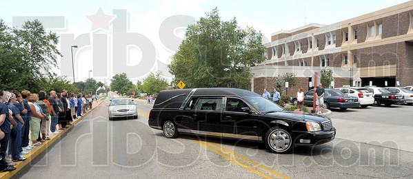 Fallen: The hearse carrying the body of fallen Terre Haute police officer Brent Long arrives at Union Hospital Tuesday afternoon.