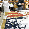 Civil War talk: Cinda May and Tom Frew discuss the digitization of Civil War relics Tuesday morning at the Sullivan County Historical Museum. The Flag is from the Civil War and was recently discovered at the Museum.