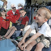 Let's go: Five-year-old Caleb Gentry (R) is all smiles as he sits in the air ambulance Tuesday afternoon with his brother Elijah (8). Air crew members Stacy Fiscus and Jeremy Bowman answer questions for the pair.