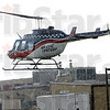 Duty calls: The Air Evac Lifeteam leaves Regional Hospital in a rain storm Tuesday evening.