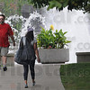 Campus crossing: Two Indiana State University students walk across campus Tuesday afternoon.