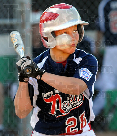 High ball: Terre Haute North's #28, Bailey Barnes lays off an incoming ball out of the strike zone during game action Tuesday evening in the opening of the West Terre Haute Little League tournament.