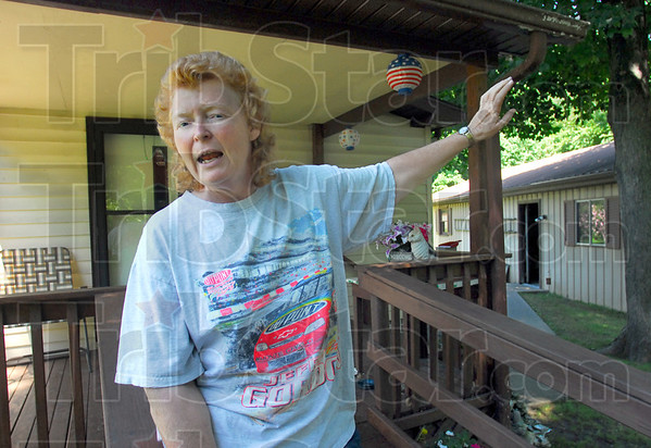 Concerned: North Terre Haute resident Becky Skelton talks about recent accidents at a CSX railroad tressel near her residence Tuesday afternoon.