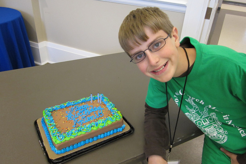 Anthony, surprised with a cake on his birthday, while at RSCM.