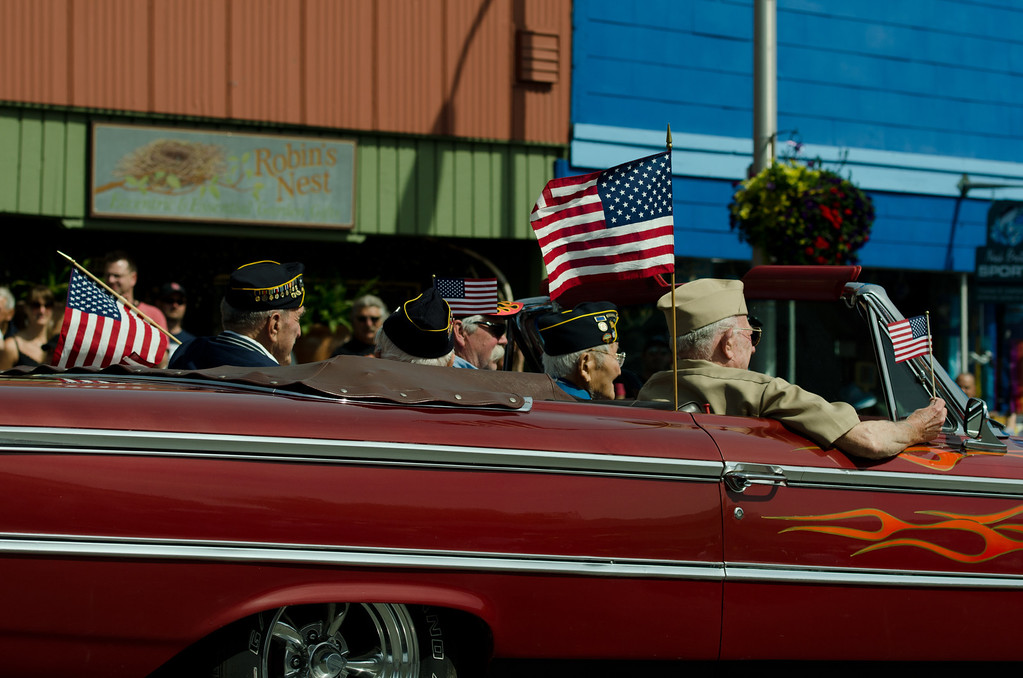 The older veterans got to ride in a vintage muscle car.