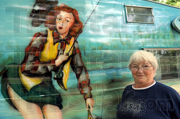 """Bomber art: Patricia Angrick had her vintage RV painted with the """"Sisters on the Fly"""" mural."""
