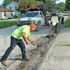 Roadwork: Vigo County Highway employees work along Windsor Road Thursday morning.