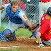 Tribune-Star/Jim Avelis<br /> Safe: Seth Lunsford loses the ball as Shawn Khale slides safe into home.