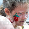 Festival face: Six-year-old Janice Brown gets her face painted during the annual Strawberry Festival at the First Congregational Church Thursday afternoon.