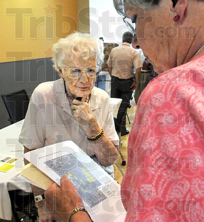 Concerned: Union Hospital area resident Helen Stewart looks a map held by her daughter dorothy McKissick during the RHIC open house.