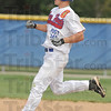 Tribune-Star/Jim Avelis<br /> Stand up play: Zach Niehaus trots onto second base with a stand up double that scored A.J. Reed, tying the game in the top of the 7th inning.