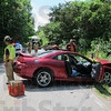 Crash: Honey Creek firefighters work the scene of a crash on McDaniel Road near Dallas Drive.