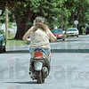 Moped: A rider cruise along a Terre Haute street Thursday afternoon.