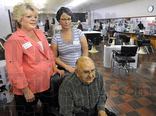New ownership: Loree Roberts (L) and daughter Britanee Roberts and Long's School founder Ernest Long talk with Tribune-Star reporter Arthur Foulkes Thursday afternoon.