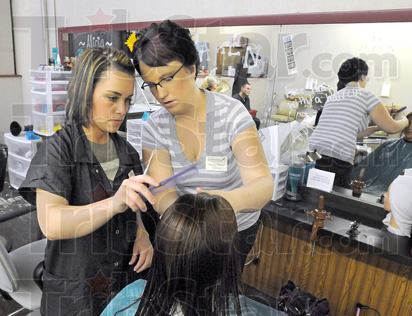 Instruction: Long's School student Brooke Morthew (L) gets instruction from Britanee Roberts Thursday afternoon.