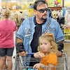Happy shopper: North side resident James Norman shops at the north Kroger store Thursday afternoon. He was very complimentary of the new store as he shops with family members.
