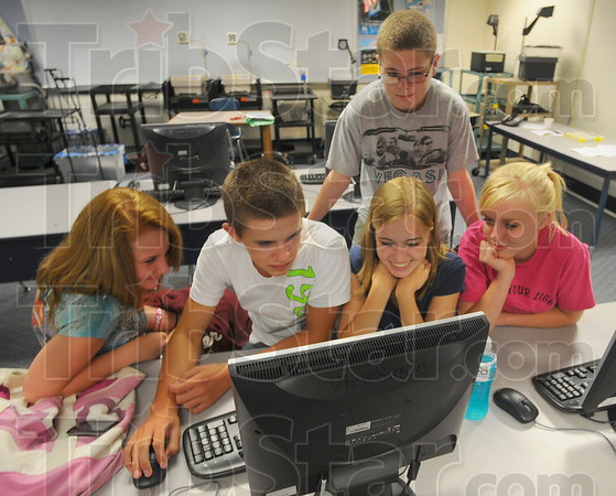 Tribune-Star/Jim Avelis<br /> Summer session: Participating in Health class this summer at Shakamak High School are Addison Klein, Johnathan Jerrell, Myranda Walters and Brenli Wasnidge, at the desk, with classmate Christian Raines standing behind them.