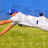 Tribune-Star/Jim Avelis<br /> Not quite: Rex center fielder Chris Manning can't quite reach a line drive.