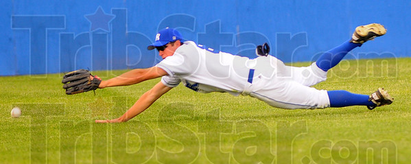 Tribune-Star/Jim Avelis<br /> Not quite: Rex center fielder Chris Manning can't quite reach a line drive.