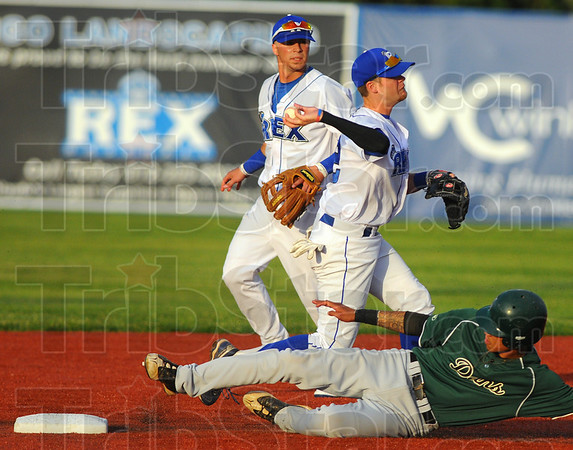 Tribune-Star/Jim Avelis<br /> Way out: Koby Kraemer watches as teammate Jordan Pearson throw to first after forcing out a Dans baserunner at second.