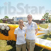 Tribune-Star/Rachel Keyes<br /> Sharing a passion: Kay Brown (left) and Melanie Abel (right) spent the day taking kids through the pre-flight process at the Terre Haute Children's Museum. The two will be competing in this year''s Air Race Classic.