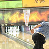 Tribune-Star/Rachel Keyes<br /> Nearly perfect: Nathan Michalowski knocks down all but one pin after rolling nine strikes in a row in early rounds at the Annual Terre Haute Open.