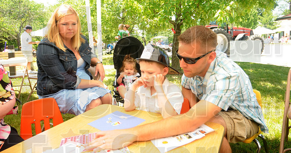 Tribune-Star/Rachel Keyes<br /> Family time: Mel Kirchner (far left) watches with daughter Reese Kirchner (left) as son Tyler Kirchner (right) and dad Kyle Kirchner make a craft at the Annual Sisters of Providence Family Day at St. Mary of the Woods.