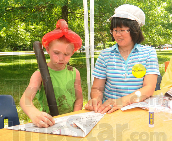 Tribune-Star/Rachel Keyes<br /> Hats: Seven-year-old Chris Compton Jr (left) gets some help from Sister Ana Ho as they make a hat together at the Sister's of Providence Family day.